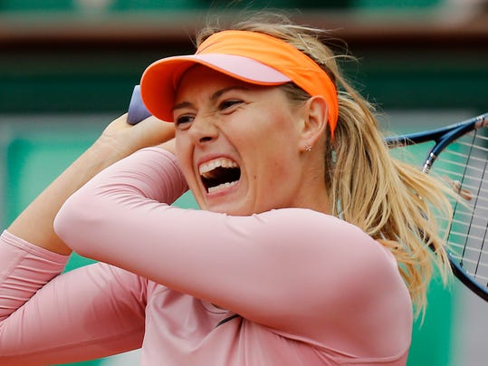 Russia's Maria Sharapova returns the ball to Bulgaria's Tsvetana Pironkova during the second round match of  the French Open tennis tournament at the Roland Garros stadium, in Paris, France, Wednesday, May 28, 2014. (AP Photo/David Vincent)