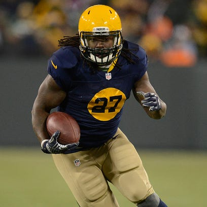 Green Bay Packers running back Eddie Lacy (27) busts