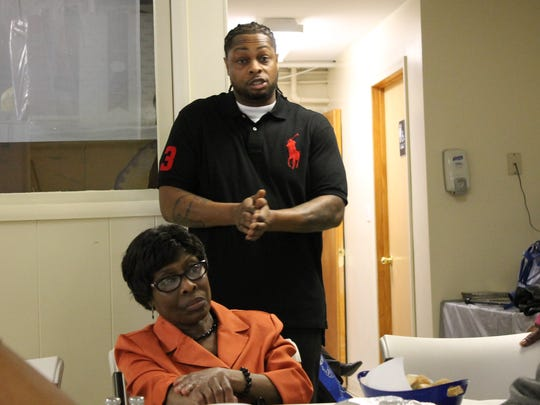 Kevin Cox, 33, of East Orange, standing, a history professor at Essex County Community College, speaks to congregants during a discussion in the basement of the 2nd Baptist Church in Belleville on Sunday, Feb. 19, 2017. Listening is his mother, Lorna Cox, seated.