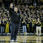 Iowa offensive tackle Brandon Scherff waves to the crowd during the first half of Friday's basketball game vs. Iowa State. Scherff was named the winner of the Outland Trophy last week.