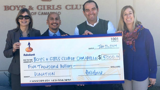 Rabobank has donated a total of $17,500 to four local Boys & Girls Clubs. From left at a presentation are Carole Davis, Rabobank Camarillo branch manager; Roberto Martinez, CEO/president of the Boys and Girls Club of Camarillo;  Ricardo Calderon, Rabobank senior wealth adviser; and Cari Shore, Rabobank retail market manager.