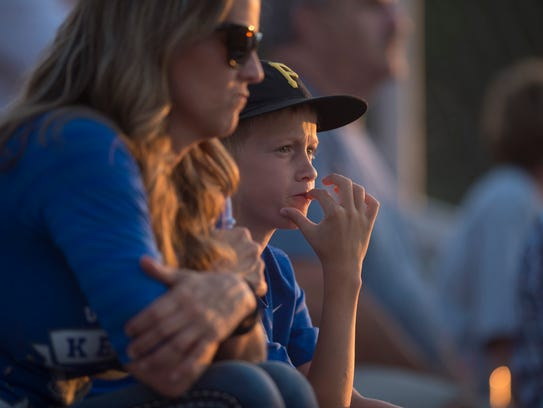 Landon Tapp, 11, and his mom, Angie, watch the Henderson