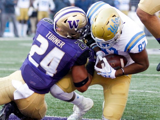 UCLA Bruins tight end Jordan Wilson catches a touchdown pass against the Washington Huskies during the second quarter at Husky Stadium.