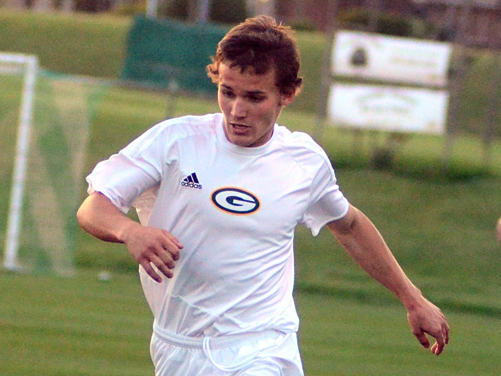 Gallatin High senior Cameron Martin dribbles upfield during first-half action. Martin had an assist in the Green Wave's 3-0 victory on Friday evening.