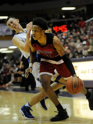 New Albany's Romeo Langford (right) drives around against Castle's Alex Hemenway (left) on Saturday in the 2017 IHSAA 4A Regional Basketball Final at Seymour High School. Castle won 72-64. March 11, 2017