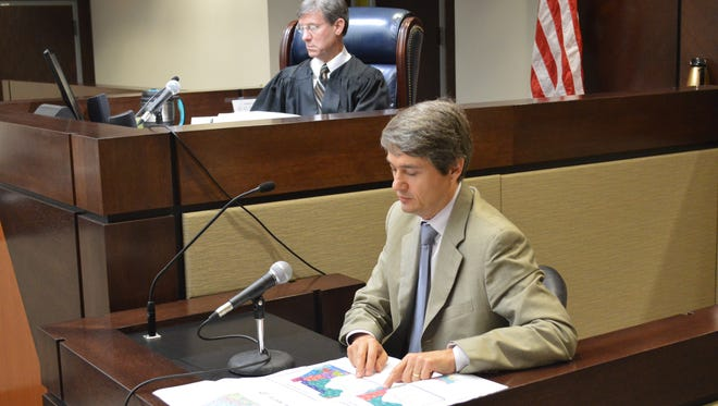 Dr. Stephen Ansolabehere, a Harvard government professor, testifies today before Circuit Judge Terry Lewis in the congressional redistricting hearing.