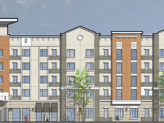 Renderings of a 128-room hotel proposed on the southwest