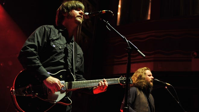 Jay Farrar (left) performs with My Morning Jacket's Jim James in New York in 2012.