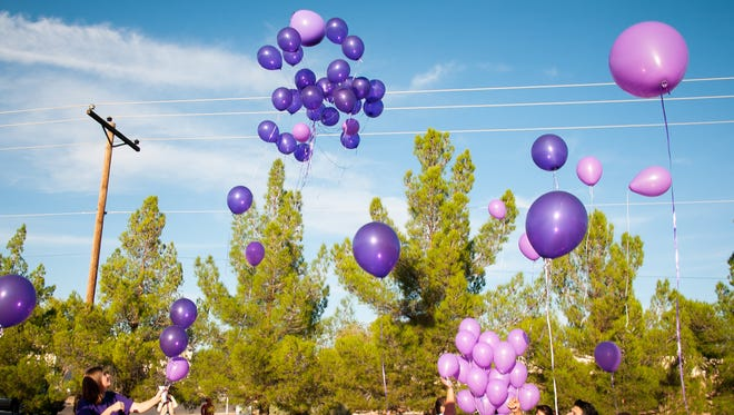 Balloons are released at the parking lot of safe housing and counseling center La Casa in Las Cruces in 2016 as part of a vigil to honor victims of domestic violence.