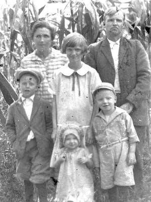 Dan Cochran poses with his family — his wife Ila; Howard, Pansy and Chester; and Peggy's and Kaye's mother, Mabel Jean — dressed in clothes provided by the photographer, c.1927