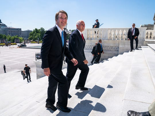 Brett Kavanaugh and Vice President Mike Pence walk