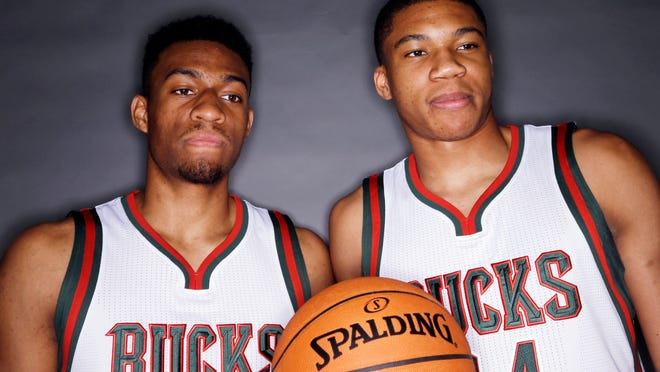 Milwaukee Bucks' Jabari Parker, left, and Giannis Antetokounmpo pose for a picture during the team's media day Monday, Sept. 29, 2014, in St. Francis, Wis. (AP Photo/Morry Gash)