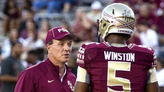 Florida State coach Jimbo Fisher tells suspended Heisman quarterback Jameis Winston to go back to the locker room and change out of uniform.