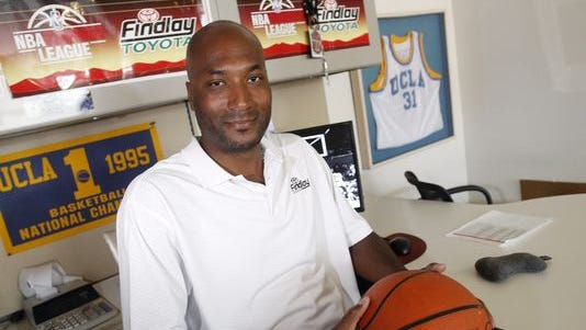 Ed O'Bannon Jr. sits in his office in Henderson, Nev. A four-year-old federal lawsuit aims to cut players in on the action and dramatically alter the financial relationship between student-athletes and the NCAA.
