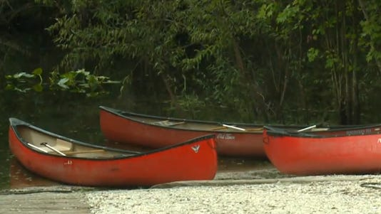 A photo taken from video shows the type of canoe a woman was in when she was attacked by an alligator.