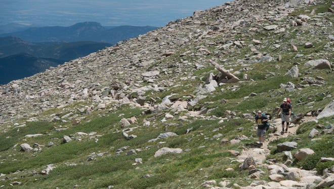 Climbers navigate the rocky trail above tree line on Longs Peak in Rocky Mountain National Park on Friday, July 19, 2017.