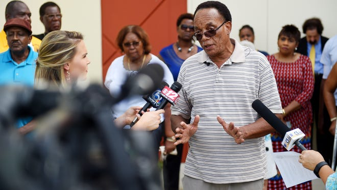Benny Rhyant, a pastor at New Mt. Sinai Baptist Church, addresses a small crowd and the media Sept. 5, 2017, at a news conference in front of the School District of Indian River County administration building in Vero Beach. The local NAACP planned the event to address recent appearances of the Confederate flag at Vero Beach High School. Representatives from the Florida State Conference of NAACP Branches and the Indian River County activist organization Pioneering Change also spoke on the issue outside the school district headquarters.