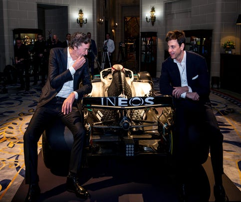 """Toto Wolff, Team Principal & CEO of The Mercedes AMG-PETRONAS F1 Team, right, and INEOS Founder and Chairman Jim Ratcliffe pose for a photo with a Mercedes F1 car and its 2020 livery during a media briefing in London, Monday, Feb. 10, 2020. The Mercedes Formula One team is still waiting to secure a long-term commitment from world champion Lewis Hamilton. Wolff says he hasn't spoken to Hamilton since the Christmas party after agreeing to """"leave each other in peace"""" in the offseason. Mercedes has longer certainty from its new sponsor INEOS, the chemicals giant owned by Jim Ratcliffe. (Steven Paston/PA via AP)"""