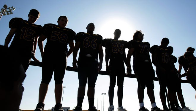 Mesa high school football players get ready for Photo Day at Mesa High School in 2010.