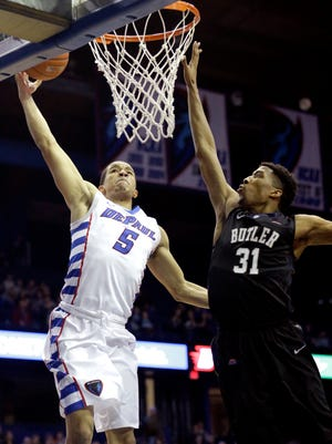 DePaul guard Billy Garrett Jr (5) goes up for a shot against Butler forward Kameron Woods (31) during the second half of an NCAA college basketball game on Saturday, Feb. 28, 2015, in Rosemont, Ill. Butler won 67-53. (AP Photo/Nam Y. Huh)