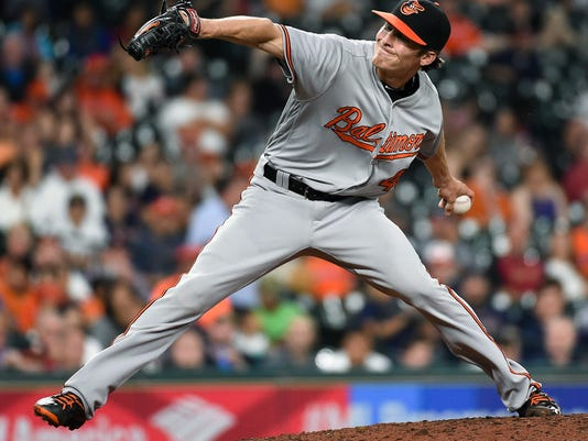 Baltimore Orioles relief pitcher Ashur Tolliver delivers during the sixth inning of a baseball game against the Houston Astros, Thursday, May 26, 2016, in Houston. (AP Photo/Eric Christian Smith)