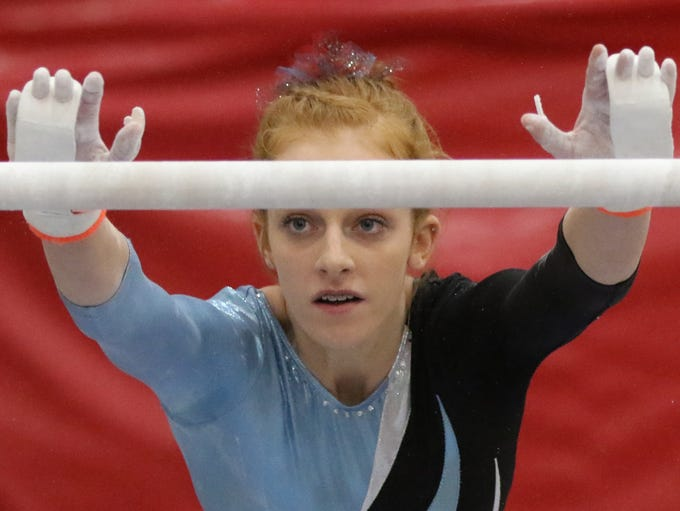 Arrowhead's Kendall Fullerton competes in uneven bars