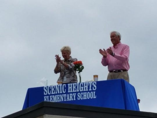 Scenic Heights Elementary Principal Mary Ellen Wiggins and her husband, former Pensacola Mayor Mike Wiggins, are pictured on the school's roof Thursday.