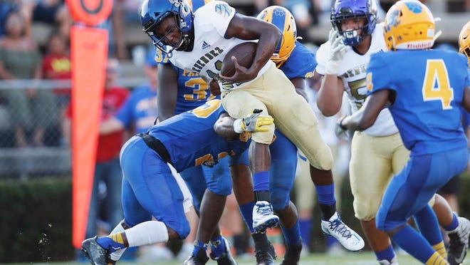 Menendez quarterback King Benford (11) ran for 213 yards and four touchdowns in an Aug. 23, 2019 win over Palatka. Benford ran for more than 100 yards in every game he finished in 2019.