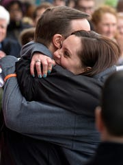Erica Laffery, daughter of slain Sandy Hook Elementary School Principal Dawn Hochsprung, gets a hug from Connecticut Sen. Chris Murphy after she delivered a speech at the March for Our Lives rally in Hartford, Conn.