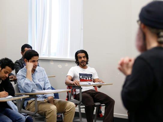 Jameel Alharbi participates in a class discussion during