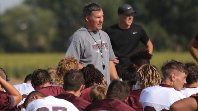 Hays High football coach Tony Crough talks to his team after a practice last year. High school fall sports practices start Monday.
