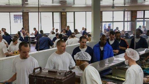 Prisoners supervised by Aramark serve inmates at a Jackson-area prison