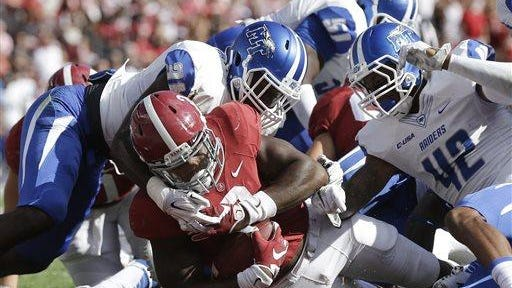 Alabama running back Derrick Henry (2) scores a touchdown in the first half against Middle Tennessee Saturday in Tuscaloosa.