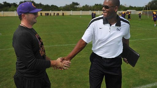 Kenny Holmes, right, is shown here with former Fort Pierce Central High School coach Josh Shaffer. Holmes, a Vero Beach High School graduate, has been hired as the new defensive coach at Florida International University.