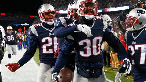 New England Patriots safety Duron Harmon (30) celebrates with teammates, including fellow Rutgers alum Logan Ryan (26), after a fourth-quarter interception against the Baltimore Ravens in the AFC divisional playoffs.