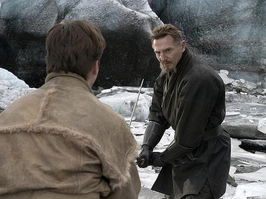 """Christian Bale and Liam Neeson in a scene from """"Batman Begins"""" (2005)."""
