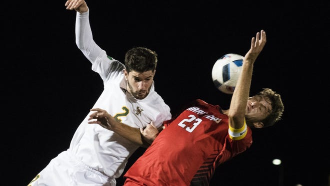 Vermont's Arthur Bacquet (2) and Hartford's Jeff Tryon (23) battle for the ball during the men's soccer game between the Hartford Hawks and the Vermont Catamounts at Virtue Field on Saturday night Octover 15, 2016 in Burlington. (BRIAN JENKINS/for the FREE PRESS)