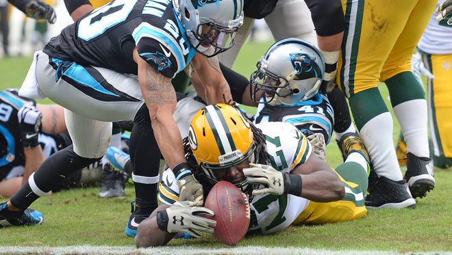 Packers running back Eddie Lacy (27) lands just short of the end zone in the first quarter against the Panthers at Bank of America Stadium in Charlotte, N.C.. The Packers scored on the next play.