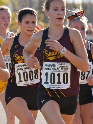 Birmingham Seaholm runners Emily Rooney and Rachel McCardell, near the 2-mile point of the Division 1 race.