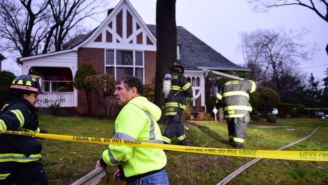 Fort Lee Firefighters are still at the scene of a house fire on the corner of Briar Way and Claremont Rd Wednesday morning, November 7, 2016.        Tariq Zehawi/NorthJersey.com