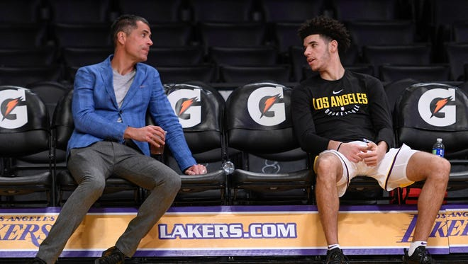 Los Angeles Lakers guard Lonzo Ball (right) chats with general manager Rob Pelinka before the start of the Lakes game against the New Orleans Pelicans at Staples Center.