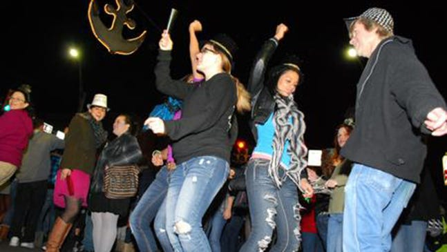 Revelers rock under the anchor at a prior New Year's Eve in Shippensburg.