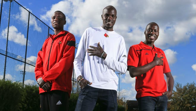 Cross country runners, from left, Ernest Kibet, Edwin Kibichiy and George Yator are three of the five Kenyans on the University of Louisville cross country team.
