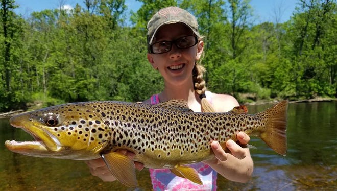 Alyssa Ostrander, West Michigan Guide Girl, says she has lost business due to changes in chumming regulations.