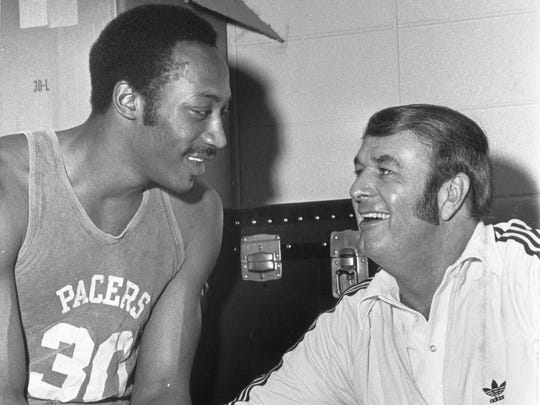 "Indiana Pacers star George McGinnis chats with coach Bobby ""Slick"" Leonard in this undated photo."