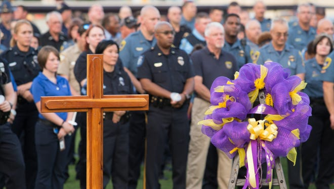 A memorial service is held in honor of Louisiana state trooper Steven Vincent in Iowa, La., on Aug. 25, 2015.