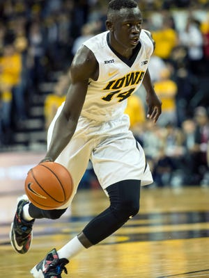 Iowa guard Peter Jok (14) drives to the basket against Penn State during the second half at Carver-Hawkeye Arena. Iowa won 73-49.