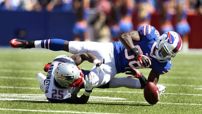 Bills receiver Marquise Goodwin (88)  is tackled by Patriots Kyle Arrington (25) and loses a fumble after a long pass reception.