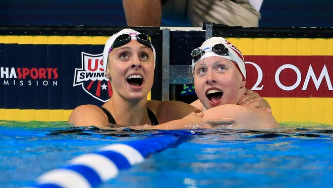 Lilly King, right, an Katie Meili, left, look at the results after King won the women's 100-meter breaststroke final at the U.S. Olympic swimming trials in Omaha, Neb., Tuesday, June 28, 2016. Meili finished in second place. (AP Photo/Orlin Wagner)