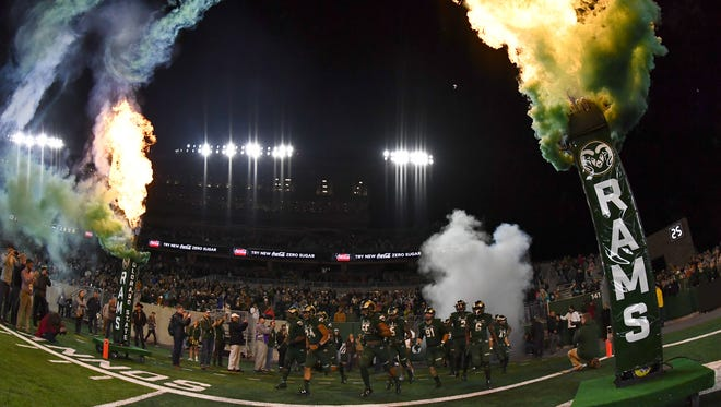 CSU's football team takes the field before the first night game at its new stadium last fall, an Oct. 14 contest against Nevada.